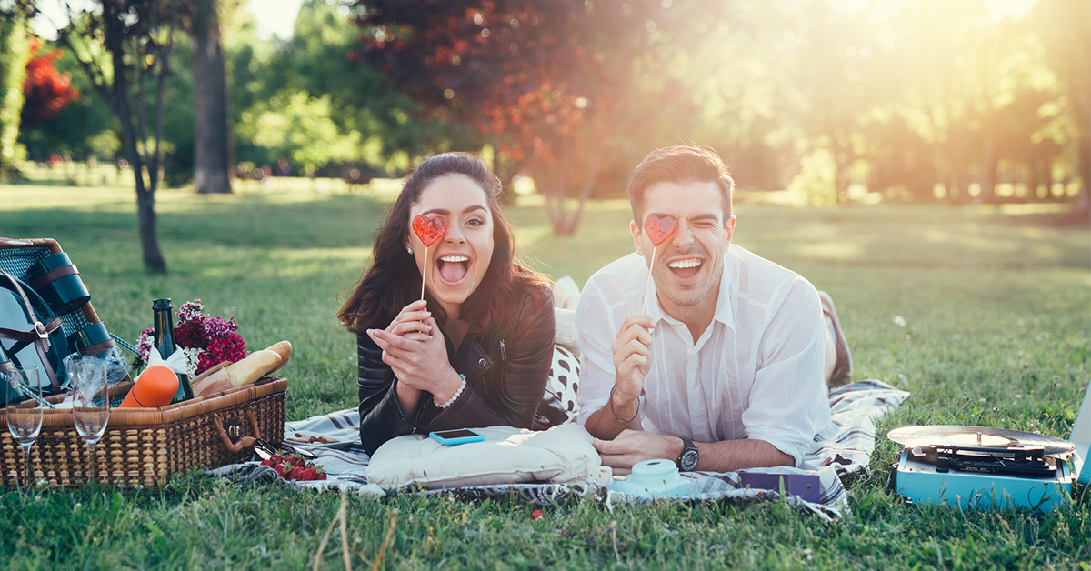 Couple photos can be posed anywhere, like a romantic or silly picnic.