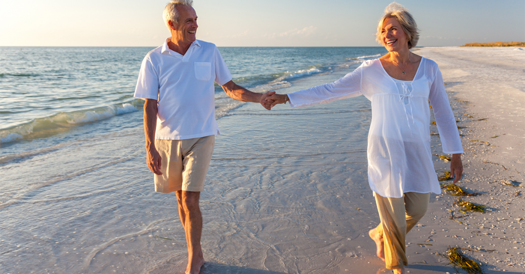 Walking on a beach is a perfect pose for couples photography.