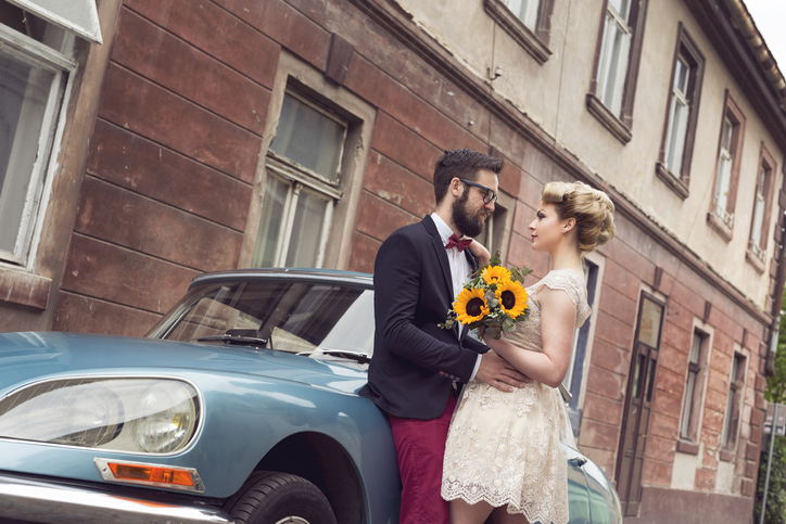 A couple bring a vintage vibe to their engagement photoshoot.