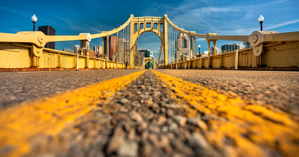 A bridge's leading lines give a low angle photo more depth than looking head on.