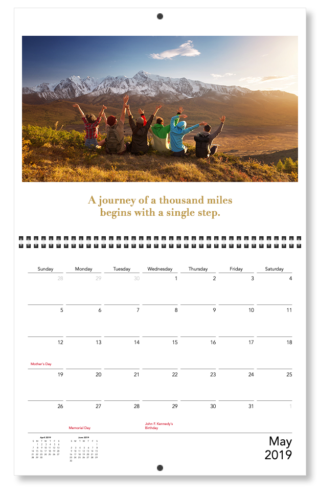 """A custom calendar with a motivation quote of """"A journey of a thousand miles begins with a single step.""""   Motif"""