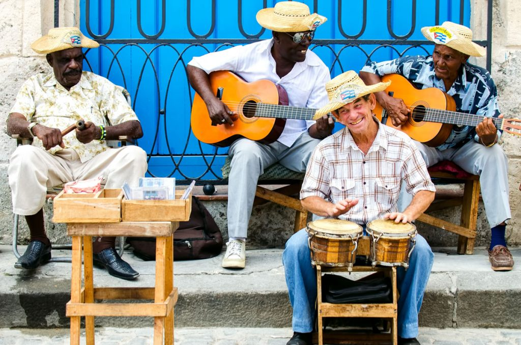 Musicians playing their instruments on a street corner | Motif